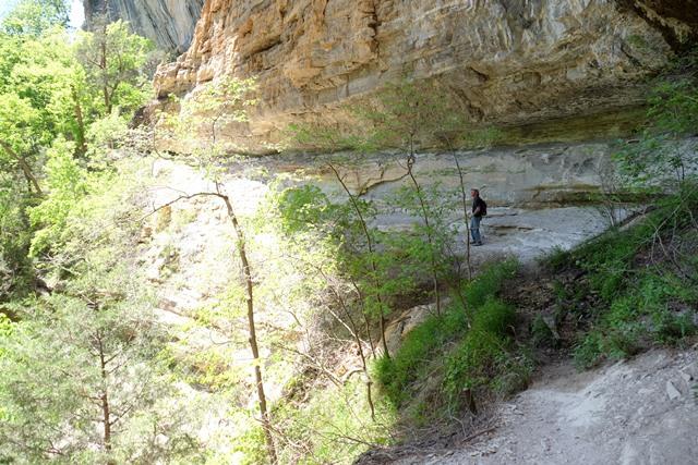 Bill exploring the cliffs beneath Hemmed-In Hollow falls