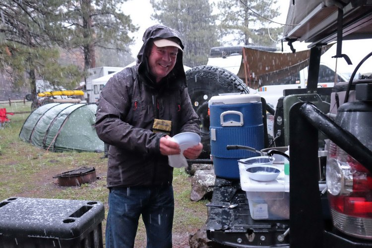Bill manages to clean up the supper dishes even in the rain and snow
