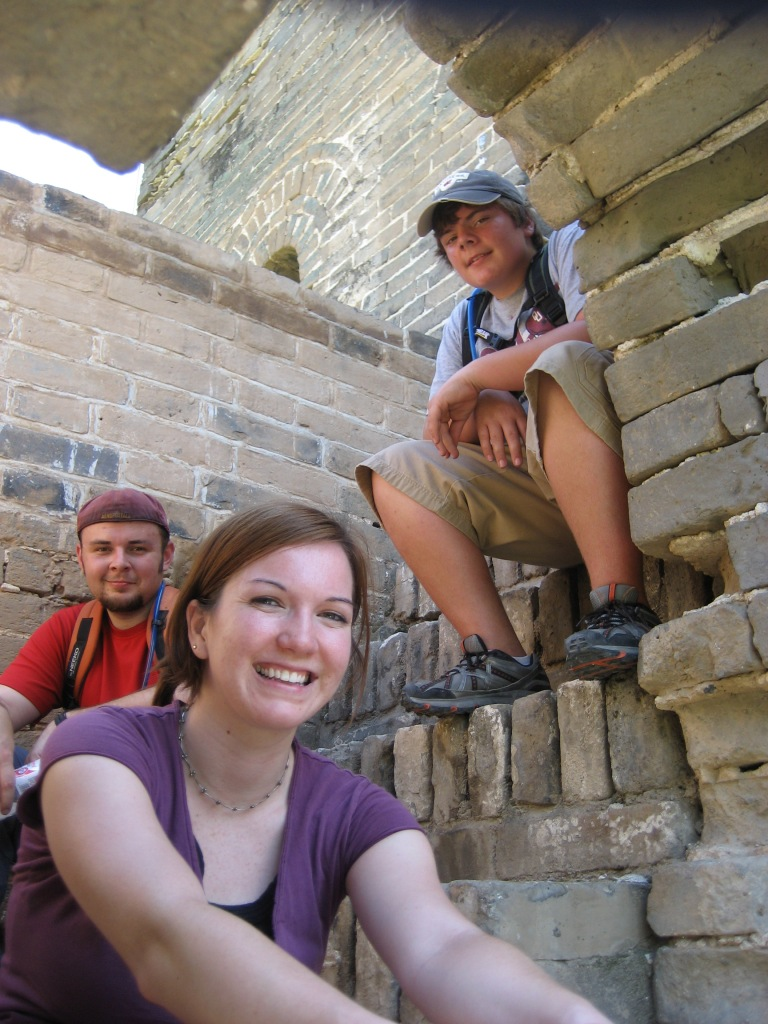 Jessica, Mark and Johnny taking a break in the shade of a watchtower along the Great Wall