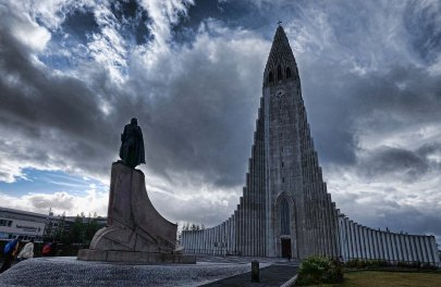 A status of Leifur Eiriksson stands in front of Hallgrimskirkja, atop the Reykjavik city center.