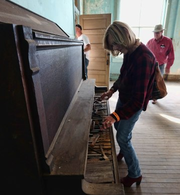 Jane Morgan finds the one key that still works on a derelict piano in the ballroom on the third floor of the Kennedy Building
