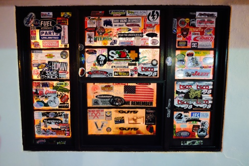 Windows at Mike's Sky Rancho are covered with stickers left by off-road enthusiasts