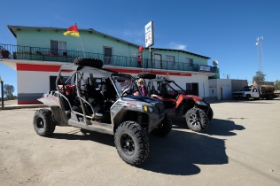 Our vehicles parked at the store where we got ice cream at La Independencia